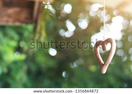 Shape wooden heart hanging on ceilng decorate in wedding ceremony. Valentine day Concept
