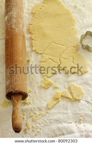 shaped cut dough and rolling pin on the table