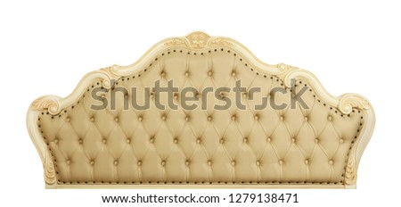 Shaped pastel beige color soft tufted leather capitone bed headboard of Chesterfield style sofa with carved wooden frame, isolated on white background, front view #1279138471
