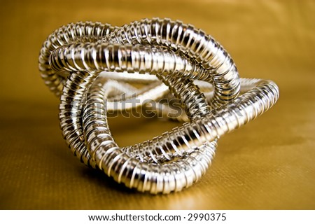 Shaped silver pipe on gold background