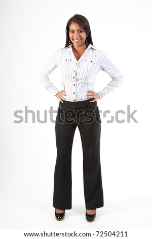 Shapely young black business woman standing with hands on hips - stock photo