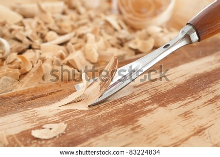 Shaping wood with a chisel.