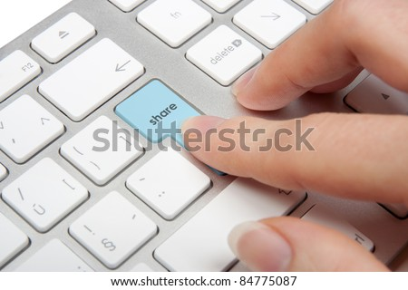Share concept - computer keyboard with share keypad pressed by woman