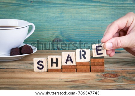 share. Wooden letters on the office desk, informative and communication background #786347743