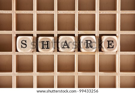 Share word construction with letter blocks / cubes and a shallow depth of field