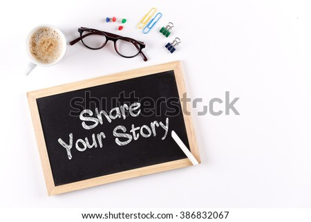 Share Your Story phrase on Chalkboard with Coffee Cup, view from above #386832067