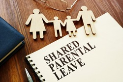 Shared Parental Leave papers and figures of family.