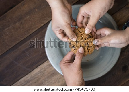 sharing concept - family sharing cookies