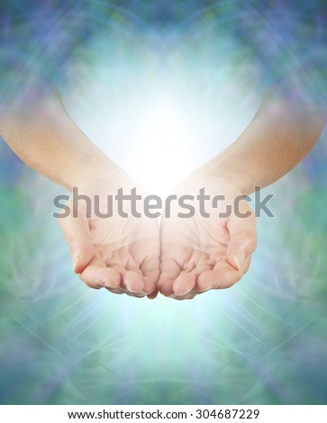 Sharing Divine Healing Energy - Female healing hands emerging from an intricate blue-green energy background cupped offering misty white energy