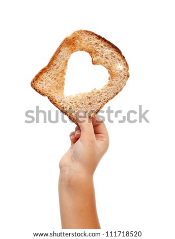 Sharing food with love - child hand with a slice of bread, isolated