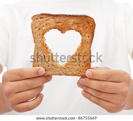 Sharing food with love - kid hands holding slice of bread