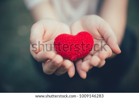 Sharing Love and Heart red color on women hand in valentine's day vintage color tone #1009146283