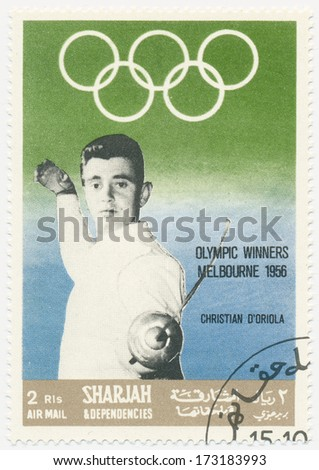 SHARJAH - CIRCA 1968: A stamp printed in Sharjah, shows portrait of Christian D Oriola (1928-2007)  was a noted French foil fencer named \