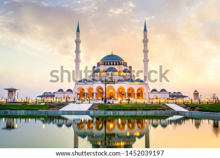 Sharjah New Mosque Largest mosque in Dubai traditional Islamic architecture, Arabic Letter means: Indeed, prayer has been decreed upon the believers a decree of specified times, Dubai Tourism Image