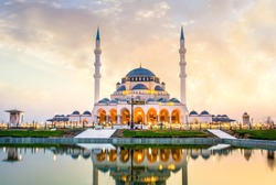 Sharjah New Mosque Largest mosque in Dubai, traditional Islamic architecture Design, famous travel  and Tourist spot in Middle East, Ramadan Kareem image, Beautiful mosque image during sunset