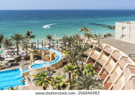 SHARJAH, UAE - SEPTEMBER 25, 2012: Sea, beach at 4-star Carlton Hotel in Sharjah. Hotel is sited on the shores of Al Khan beach. Resort features 173 guest rooms and chalets. United Arab Emirates.