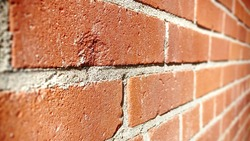 Sharp and detailed brick wall image with depth of field focus blur