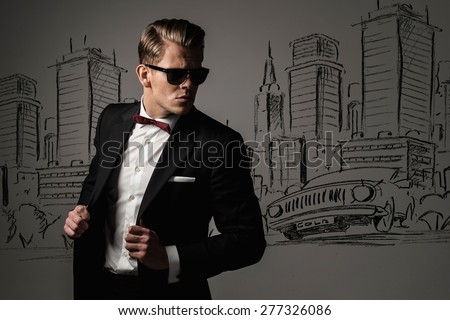 Stock Photo Sharp dressed man in black suit against city panorama drawing