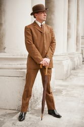 Sharp Dresser In Brown Suit And Matching Bowler Hat