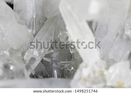 Sharp macro close-up picture of crystal quartz spikes suitable for showing mining industry concept and natural resources development