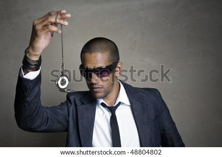 Sharp modern man looks at his old pocket watch