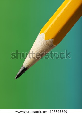 sharp pencil tip on turquoise and green gradient