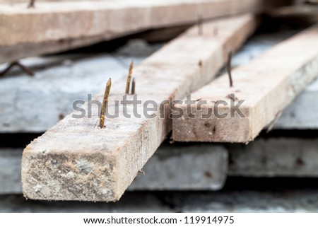 sharp rusty nail stick on wood