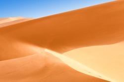 Sharp slopes of the desert dunes in the Algeria
