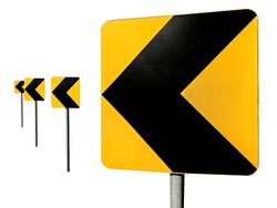 Sharp turn road signs. Black arrows on yellow traffic sign pointing left.