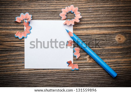 Sharpened blue color pencil with paper and wood shavings