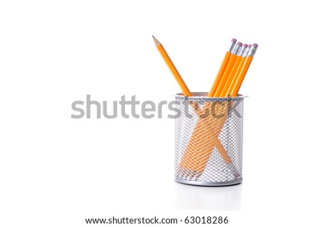 Sharpened HB pencil in a holder on a white background.