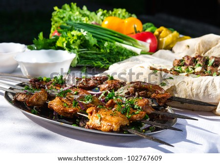 Shashlik with lavash and vegetables