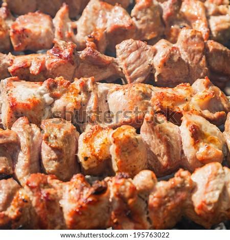 Shashlyk (kebab) grilling on the bbq, closeup view