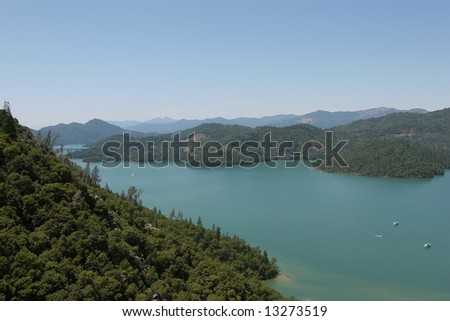 Shasta Lake is a reservoir created by the building of Shasta Dam in California, USA. Shasta Lake is the 3rd largest lake in California.