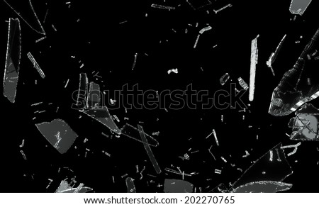 Shattered and splitted glass Pieces isolated on black