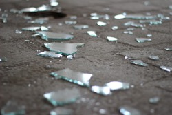 Shattered glass on a stone floor