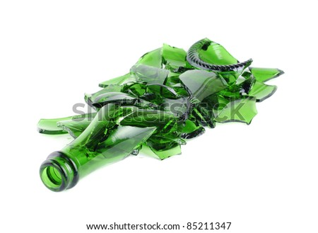 Shattered green champagne bottle isolated on the white background
