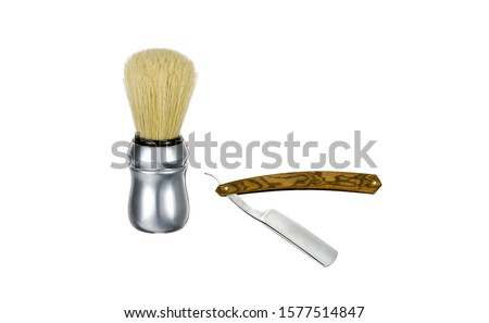 Shaving brush and straight razor isolated on white background. Barber shaving brush and razor. Shaving brush with straight razor isolated on white