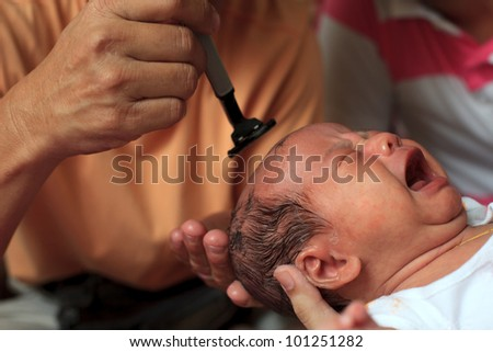 shaving hair of new born infant when one month aged tradition of thai people