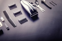 Shaving, Razor, brush, Comb, scissor, clippers and hair trimmer. Accessories for Barber shop equipment on black background Top view copyspace