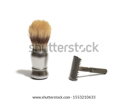 Shaving stick and shaving brush on white background, isolated