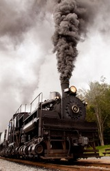 Shay engine 6 burns coal as it heads out of the station at Cass Scenic Railroad State Park in Cass, West Virginia.