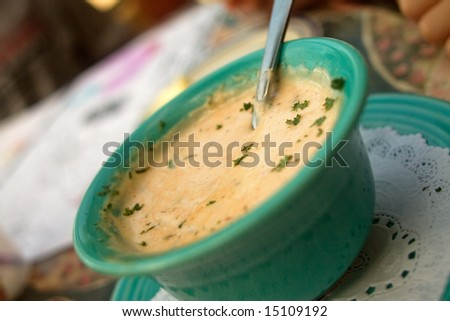 She Crab Chowder Appetizer in blue bowl.