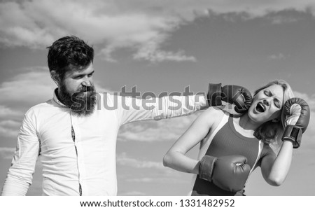She did not expect be attacked. Prepare for sudden attack. Woman undergoes violence. Stop violence. Learn to resist punch. Couple in love boxing gloves sky background. Man punch girl boxing glove.