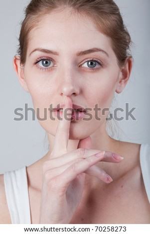 she holds a finger to his mouth calls to be quieter