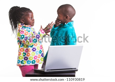 She is fighting with her buddy about something he did on the computer.