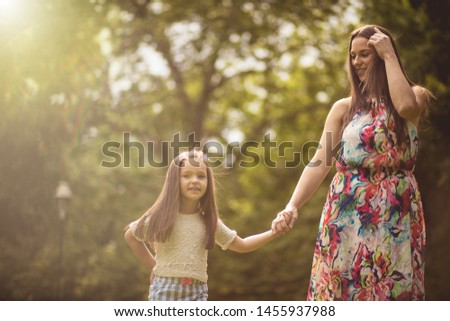 She is her little favorite person. Mother and daughter in nature. #1455937988