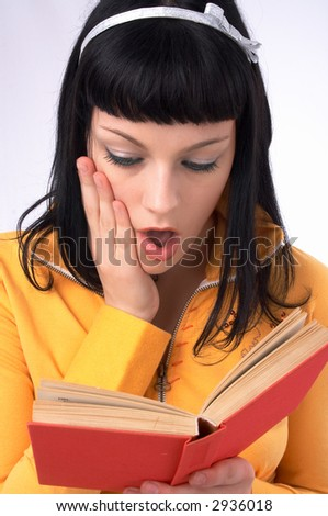 she is reading a book and she is surprised