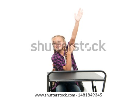 She is up on her homework. Adorable small child raising hand to recite homework isolated on white. Doing homework assignment. Homework supervision.
