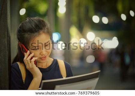 she talking photo at restaurant Bangkok,Thailand #769379605